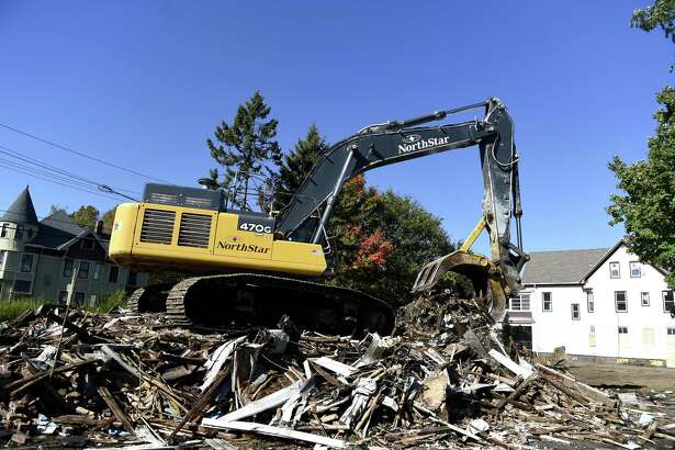 Demolition began Thursday morning at 53 Main St. in West Haven to make way for development of The Haven, an upscale shopping outlet mall.