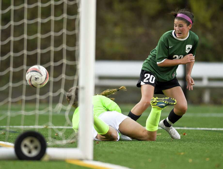 Greenwich Academy Taylor Lane (20) scores on Greens Farms Academy goalie Kendra Offermann in the first half of play in a FAA girls soccer game at Greenwich Academy in Greenwich, Connecticut on Thursday, Oct.19, 2017. Greenwich Academy won 4-0. Photo: Matthew Brown / Hearst Connecticut Media / Stamford Advocate