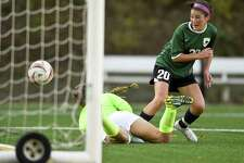 Greenwich Academy Taylor Lane (20) scores on Greens Farms Academy goalie Kendra Offermann in the first half of play in a FAA girls soccer game at Greenwich Academy in Greenwich, Connecticut on Thursday, Oct.19, 2017. Greenwich Academy won 4-0.