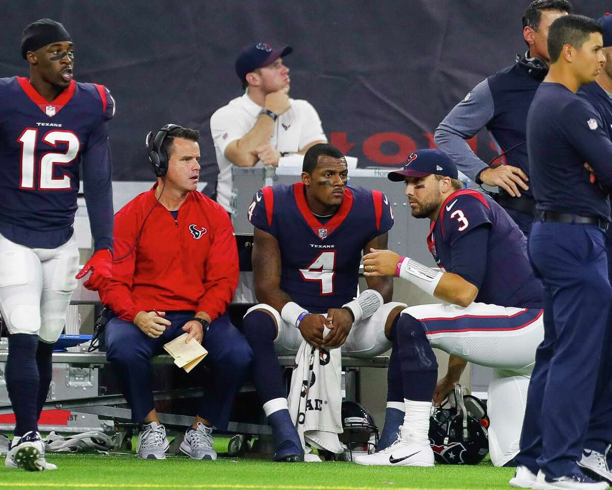 Texans quarterback Deshaun Watson, left, will now take a seat for the rest of the season as former starter turned backup Tom Savage takes over.