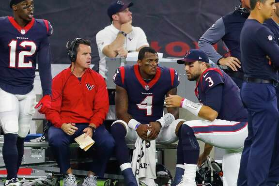 Texans quarterback coach Sean Ryan, left, with rookie Deshaun Watson, center, and backup Tom Savage. Ryan has been impressed with Watson's talent, work ethic and desire to become the best player he can be.