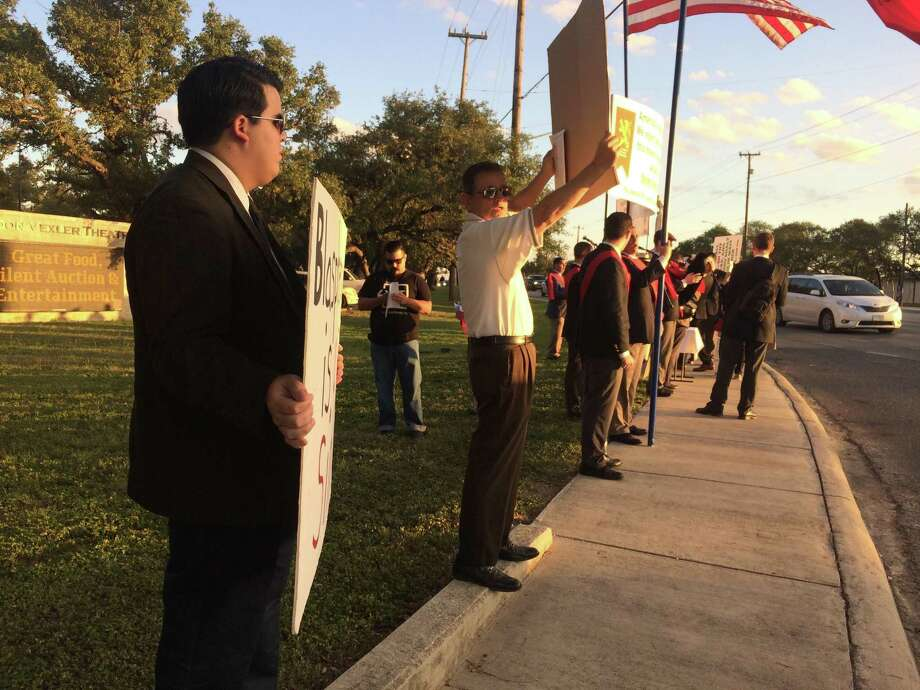 About three dozen protesters gathere just outside the Barshop Jewish Community Center Thursday night to protest the production of 'An Act of God.' Photo: Deborah Martin /San Antonio Express-News