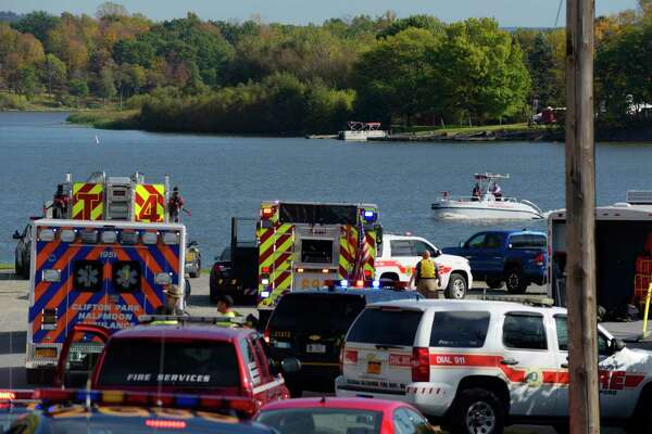 Rescue workers at the scene near the Crescent Bridge where a vehicle went into the Mohawk River on Thursday, Oct. 19, 2017.  (Paul Buckowski / Times Union)