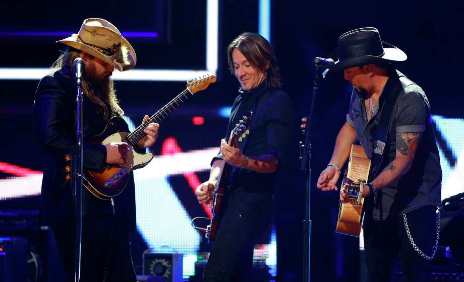 Chris Stapelton, left, Jason Aldean and Keith Urban perform at 2017 CMT Artist of the Year Awards at Nashville's Schermerhorn Symphony Center on Wednesday, Oct. 18, 2017, in Nashville, Tenn. (Photo by Wade Payne/Invision/AP) ORG XMIT: TNWP122 Photo: Wade Payne / Invision