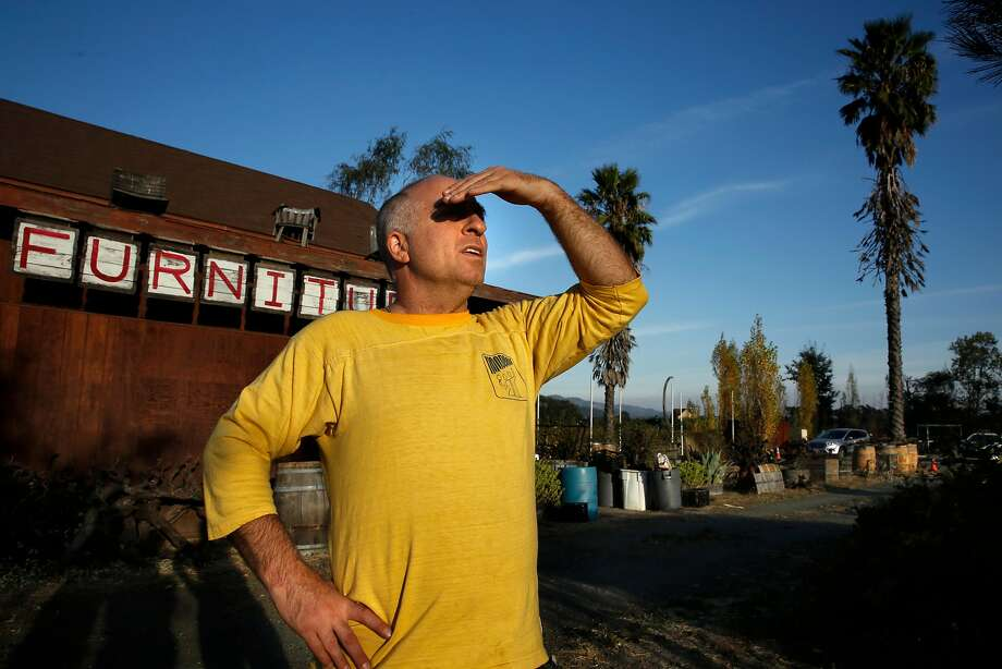 Paul Block, owner of Wine Barrel Furniture in Calistoga, looks toward the path of the Tubbs Fire across from his property. Block stayed put as the fire eventually burned around his place. Photo: Michael Macor, The Chronicle