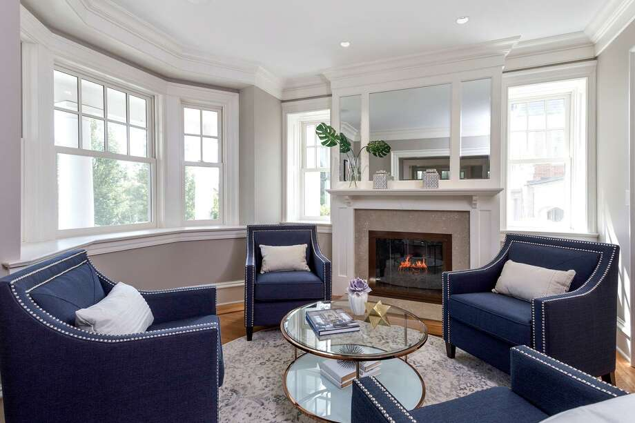 New housing in central Greenwich is capitalizing on access to the train station, shopping and dining. The house at 58 Ridge Street is an example of homes that are seeking to attract buyers to the area who want a blend of opulence and expedience. Photo: Contributed Photo / Contributed / Greenwich Time Contributed