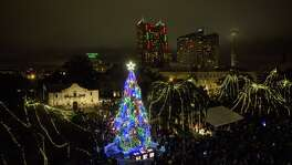 A 55-foot white fir is lit during the 31st Annual H-E-B Christmas Tree Lighting Celebration at Alamo Plaza on Nov. 27, 2015.