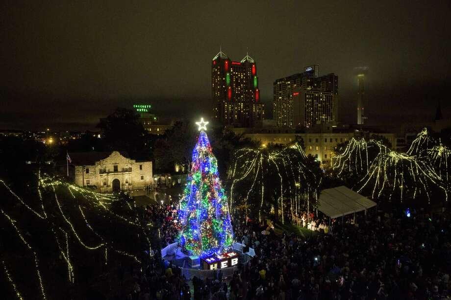 A 55-foot white fir is lit during the 31st Annual H-E-B Christmas Tree Lighting Celebration at Alamo Plaza on Nov. 27, 2015. Photo: Carolyn Van Houten /San Antonio Express-News / 2015 San Antonio Express-News