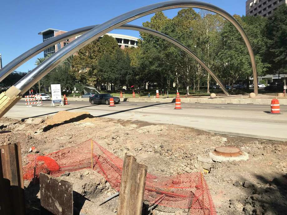 Crews work along the southbound side of Post Oak Boulevard, which is being widened for dedicated bus lanes through the Uptown area. Photo: Dug Begley