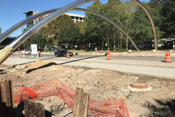 Crews work along the southbound side of Post Oak Boulevard, which is being widened for dedicated bus lanes through the Uptown area.