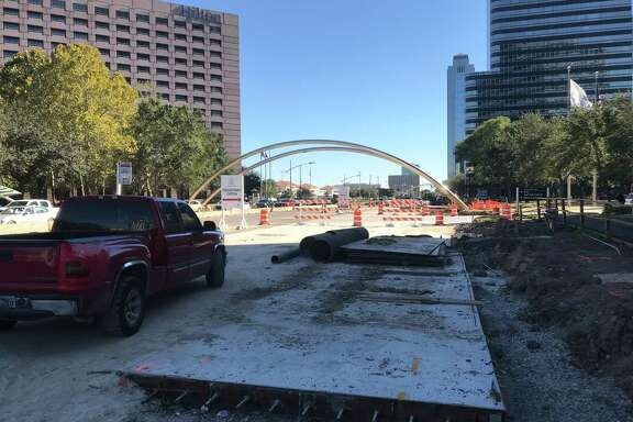 Crews continue work on Oct. 17 along the southbound side of Post Oak Boulevard, which is being widened for dedicated bus lanes through the Uptown area in Houston. Workers will also expand the iconic metal arches that line the street, and relocate one.
