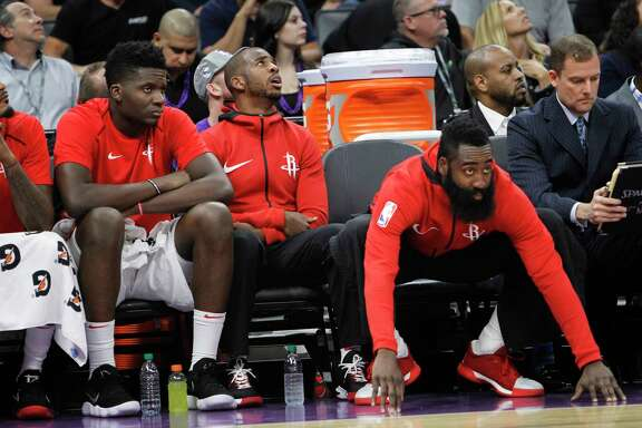 The integration of guard Chris Paul, right, into the system has been slowed by his bruised knee - he didn't play in the second game. But center Clint Capela, left, helped make for his absence with 22 points and 17 rebounds against the Kings.