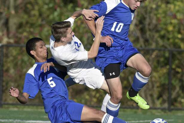 Abbott Tech's Patrick Ryan (12) and Wilcox Tech's Isaac Marks (5) and Jayden Myles collide going for the ball during their game Thursday afternoon at Broadview Middle School in Danbury.