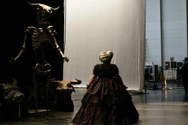 Alibina Shagimuratova walks bakc stage during the dress rehearsal of the Houston Opera's production of La Traviata on Tuesday, Oct. 17, 2017, in Houston. ( Elizabeth Conley / Houston Chronicle )