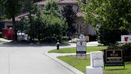 Dumpsters, for sale and for lease signs along with numerous contractor signs dot the many cul-de-sacs undergoing flood repair and renovation in the Timarron Lakes neighborhood in the Woodlands after Hurricane Harvey ripped through the community,