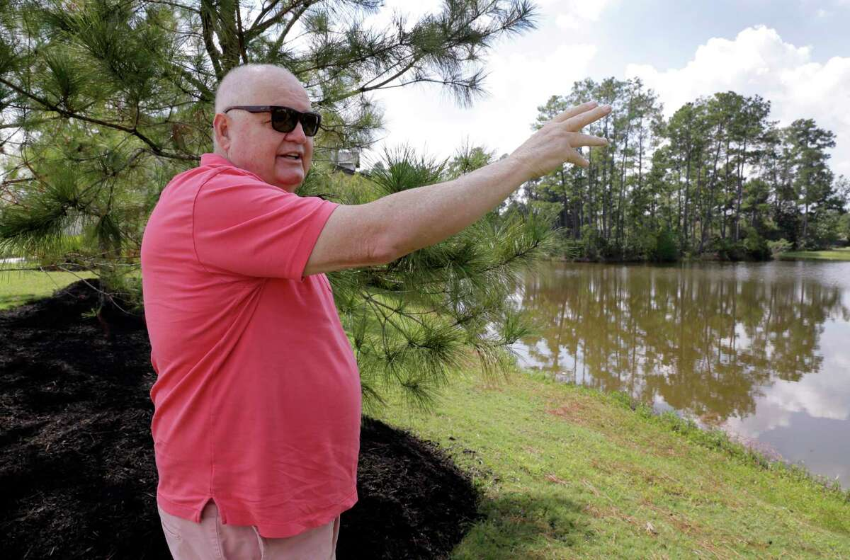 Timarron Lakes resident Frank Gore, whose home has flooded twice in three years, on the bank of the neighborhood pond talks about how the original developers made changes to the natural Spring creek flow that he and other residents believe exacerbate the flooding in the neighborhood in Tomball, TX, Oct. 13, 2017. (Michael Wyke / For the Chronicle)