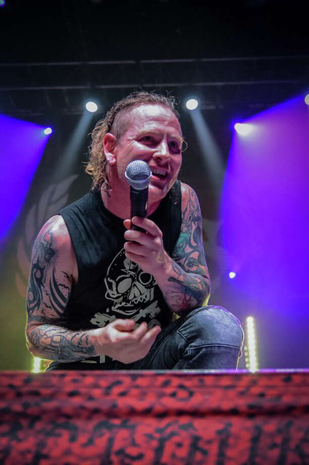 Stone Sour's Corey Taylor holds the microphone up towards the crowd at Revention Music Center in Houston on Sunday, Oct. 15, 2017. Photo: Laura MacPherson