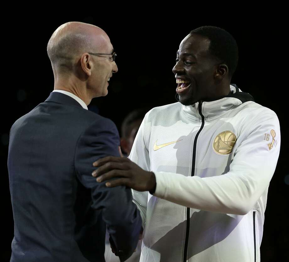 NBA commissioner Adam Silver, left, congratulates Golden State Warriors' Draymond Green during a ring ceremony prior to the basketball game against the Houston Rockets Tuesday, Oct. 17, 2017, in Oakland, Calif. (AP Photo/Ben Margot) Photo: Ben Margot, Associated Press
