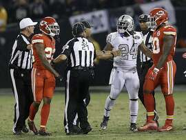 Oakland Raiders running back Marshawn Lynch (24) talks with officials before he was ejected during the first half of an NFL football game between the Raiders and the Kansas City Chiefs in Oakland, Calif., Thursday, Oct. 19, 2017. (AP Photo/Ben Margot)