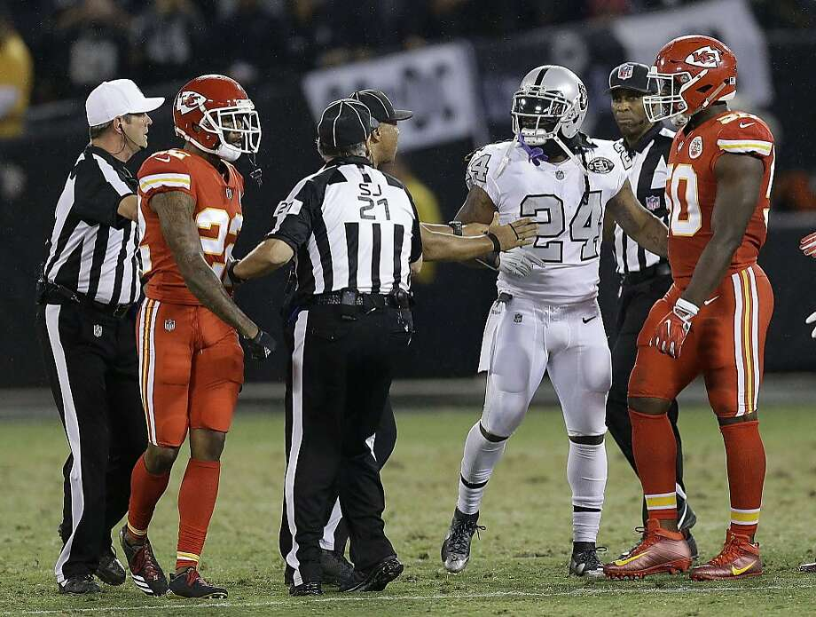 Oakland Raiders running back Marshawn Lynch (24) talks with officials before he was ejected during the first half of an NFL football game between the Raiders and the Kansas City Chiefs in Oakland, Calif., Thursday, Oct. 19, 2017. (AP Photo/Ben Margot) Photo: Ben Margot, Associated Press