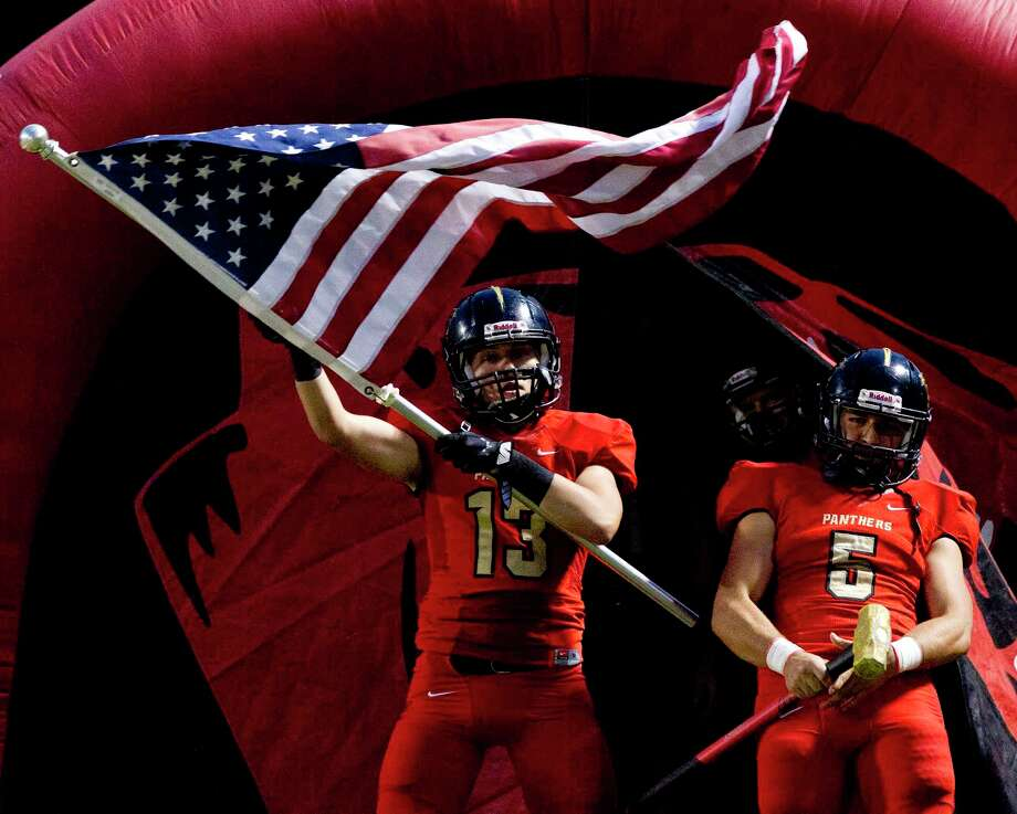 Caney Creek wide receiver Jayden Spalding (13) waves an American flag during the first quarter of a District 21-5A high school football game at Buddy Moorhead Stadium, Thursday, Oct. 19, 2017, in Conroe. Photo: Jason Fochtman, Staff Photographer / © 2017 Houston Chronicle
