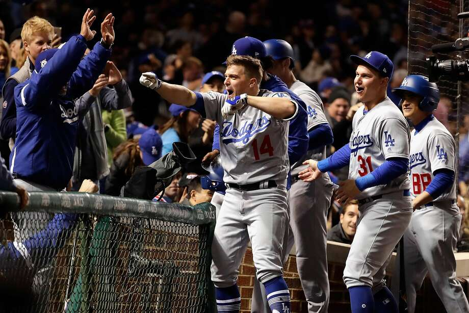Enrique Hernandez celebrates with teammates after hitting a grand slam to put L.A. up big in the third. Photo: Jamie Squire, Getty Images