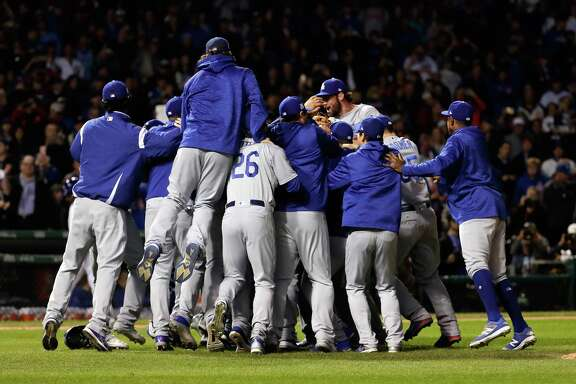 CHICAGO, IL - OCTOBER 19:  The Los Angeles Dodgers celebrate defeating the Chicago Cubs 11-1 in game five of the National League Championship Series at Wrigley Field on October 19, 2017 in Chicago, Illinois. The Dodgers advance to the World Series.