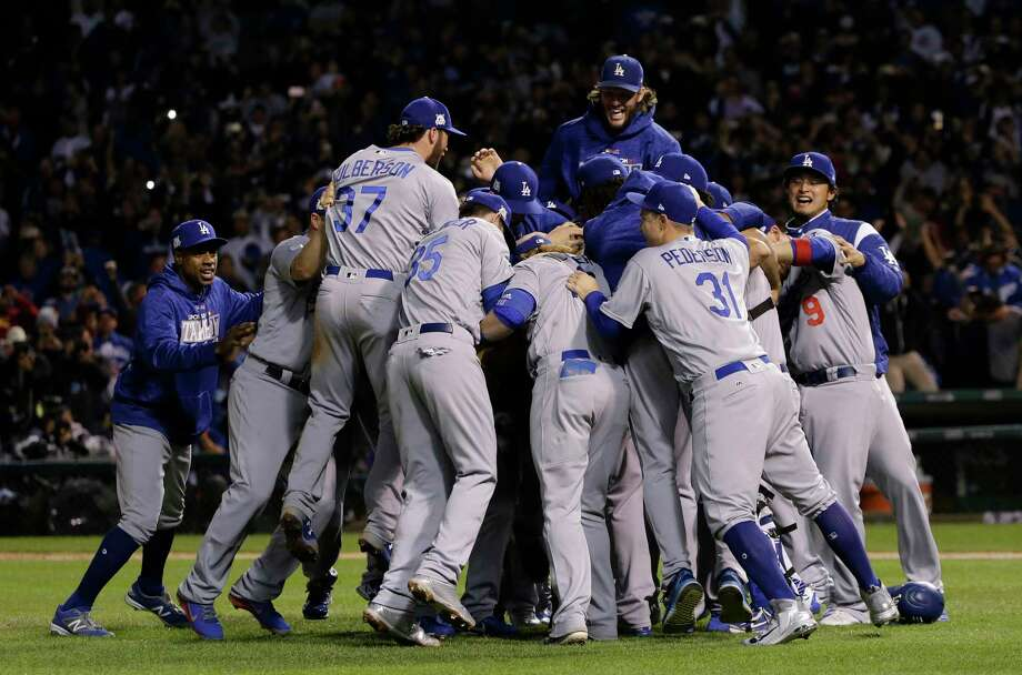 The Los Angeles Dodgers players celebrate after Game 5 of baseball's National League Championship Series against the Chicago Cubs, Thursday, Oct. 19, 2017, in Chicago. The Dodgers won 11-1 to win the series and advance to the World Series. (AP Photo/Nam Y. Huh) Photo: Nam Y. Huh, Associated Press / Copyright 2017 The Associated Press. All rights reserved.