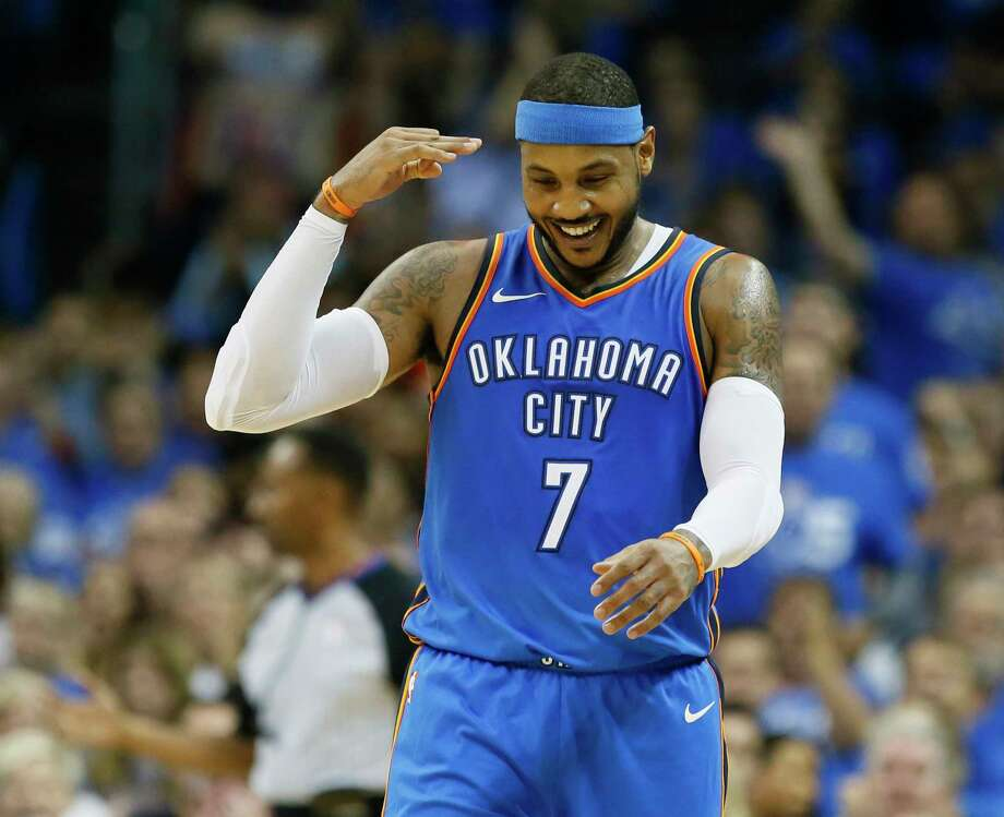 Oklahoma City Thunder forward Carmelo Anthony (7) gestures after hitting a three-point basket in the second quarter of an NBA basketball game against the New York Knicks in Oklahoma City, Thursday, Oct. 19, 2017. (AP Photo/Sue Ogrocki) ORG XMIT: OKSO107 Photo: Sue Ogrocki / AP2017