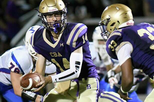 Saratoga's Christian Brothers Academy quarterback Dom Meola (14) hands the ball to running back Collin Dukes (33) during a Section II Class AA high school football game in Colonie, N.Y., Friday, Sept. 22, 2017. (Hans Pennink / Special to the Times Union) ORG XMIT: HP114