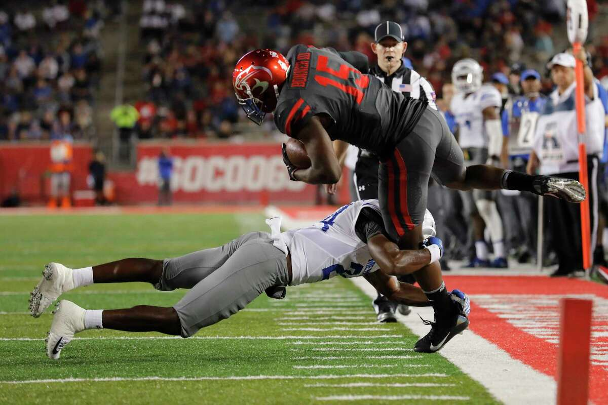 Memphis Tigers defensive back Tito Windham #24 drives Houston Cougars wide receiver Linell Bonner #15 out of bounds near the goal line in the second quarter during the NCAA football game between the Memphis Tigers and the Houston Cougars at TDECU Stadium in Houston, TX on Thursday, October 19, 2017.