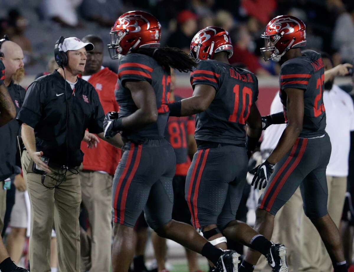 Houston Cougars head coach Major Applewhite greets defensive tackle Ed Oliver #10 on the sideline after a second quarter sack during the NCAA football game between the Memphis Tigers and the Houston Cougars at TDECU Stadium in Houston, TX on Thursday, October 19, 2017.