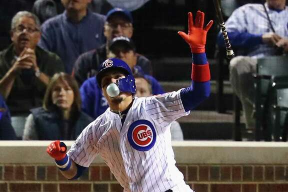 CHICAGO, IL - OCTOBER 18:  Javier Baez #9 of the Chicago Cubs reacts to hitting a home run in the fifth inning against the Los Angeles Dodgers during game four of the National League Championship Series at Wrigley Field on October 18, 2017 in Chicago, Illinois.  (Photo by Stacy Revere/Getty Images)