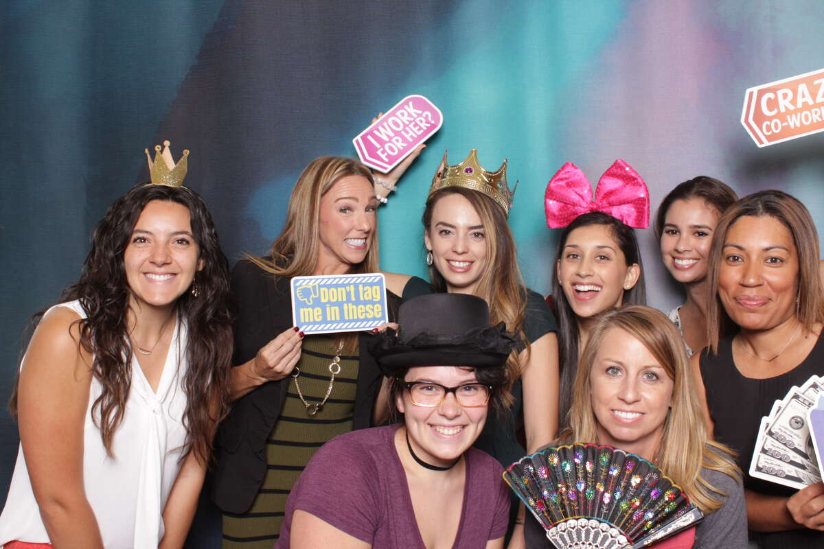 Attendees of the 2017 Top Workplaces luncheon pose for the camera at the event's photo booth. The luncheon, hosted at the Grand Hyatt on Oct. 19, honored the businesses in San Antonio that were voted the best places to work.