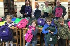 Members of AT&T Michigan Pioneers recently presented 70 backpacks filled with school supplies to school administrators from Ubly Elementary School. The backpacks will be donated to students in need of school supplies. (Submitted Photo)