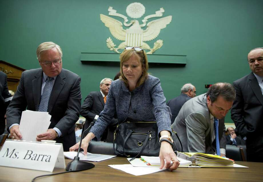 General Motors CEO Mary Barra, center, in April 2014 in Washington, D.C., while testifying before the House Energy and Commerce subcommittee on Oversight and Investigation on ignition switch safety defects in GM vehicles. (AP Photo/Evan Vucci) Photo: Evan Vucci / AP / AP