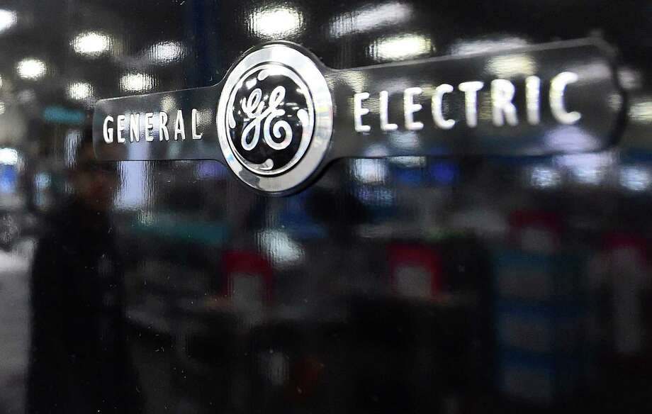 "General Electric promised ""sweeping changes"" in revealing its third quarter results on Friday, Oct. 20, 2017, including selling off $20 billion in business assets. Photo: FREDERIC J. BROWN / AFP /Getty Images / AFP or licensors"