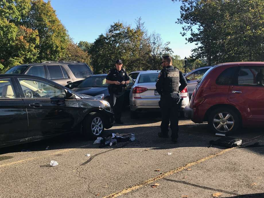 Two people were hurt and at least 10 parked cars were damaged when an elderly woman struck the vehicles on Friday, Oct. 20, 2017 rear parking lot of Fountain Terrace apartments on Strawberry Hill in Stamford. Photo: John Nickerson /Hearst Connecticut Media