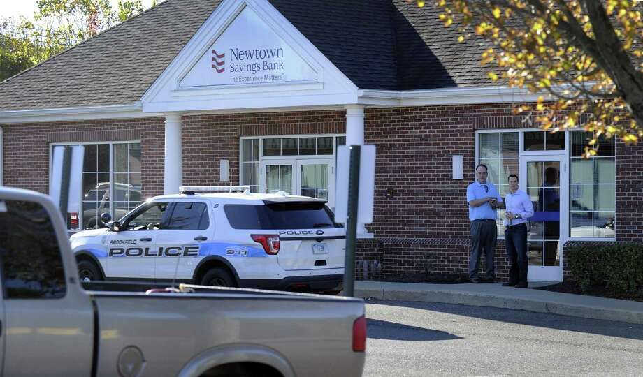 Police searched for a suspect wanted in connection to a bank robbery at the Newtown Savings Bank on Federal Road in Brookfield, Friday morning, Oct. 20, 2017 Photo: Carol Kaliff / Hearst Connecticut Media / The News-Times