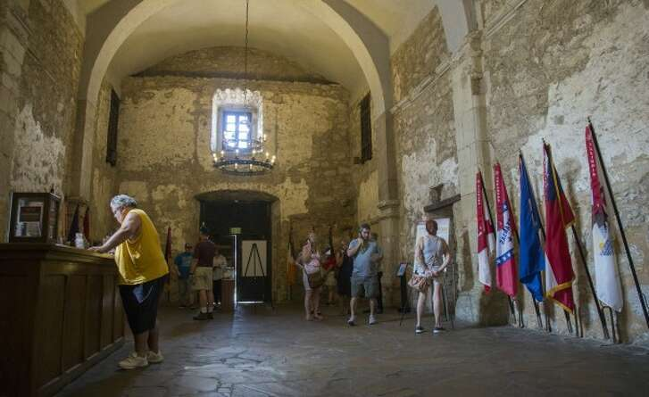 Visitors enter the Alamo on Monday, Oct. 2, 2017, in San Antonio. Portions of the building were blocked off from the public so Alamo staff members could monitor the decay of the building (ANA RAMIREZ, Austin American-Statesman).