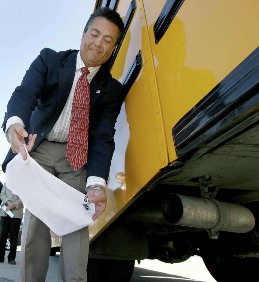 Wayne Nastri, regional adminstrator with the Environmental Protection Agency, holds a white handkerchief to the exhaust pipe of a school bus to demonstrate a cleaner burning diesel fuel in Sacramento, Calif. on Tuesday, August 22, 2006.  On September 1, all California retailers are required to begin selling the ultra low sulfur diesel fuel which will reduce the amount of particulates released into the air.  PAUL CHINN/The Chronicle **Wayne Nastri (EDS NOTE: Additional cutline info can be obtained at www.clean-diesel.org or www.wspa.org) Ran on: 08-23-2006 Environmental Protection Agency's Wayne Nastri holds a white cloth to the exhaust pipe of a bus Tuesday in Sacramento to show a cleaner burning diesel fuel that will allow the use of cleaner engines and advanced emissions control devices. By 2030, the annual emission reductions will be equivalent to removing 90 percent of the pollution produced by today's trucks and buses. Photo: PAUL CHINN / SFC / The Chronicle