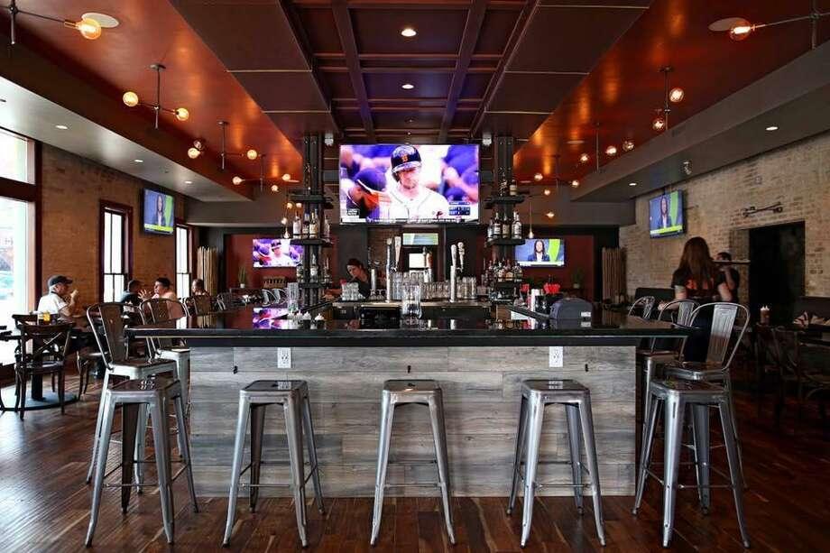 The bar at Smoke: BBQ + Brew + Venue. Photo: Courtesy Adrian Martinez