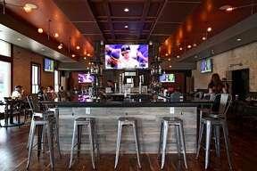 The bar at Smoke: BBQ + Brew + Venue.