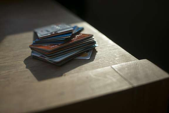 Some of Udean Murray�s credit cards, which she uses to supplement medical needs and other expenses, in New York, Oct. 18, 2017. Card debt has soared to record levels, generating big profits for banks but leaving some people with unmanageable payments. (Andrew Seng/The New York Times)