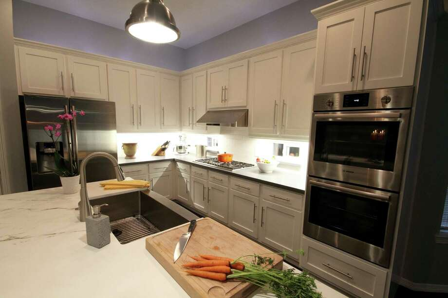 This remodeled kitchen is the winner of a Houston's Best PRISM Award. Photo: Courtesy Of Vick Construction & Remodeling