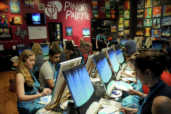Students paint during class at Pinot's Palette on Taft St. Friday  Oct. 13, 2017.(Dave Rossman Photo)