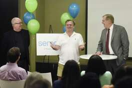 Sema4 President and COO Jamie Coffin, Ph.D., left and CEO Eric Schadt, Ph.D., center, and Stamford Mayor David Martin speak at the Sema4 headquarters at 333 Ludlow St., in Stamford, Conn., on Wednesday, Oct. 11, 2017.
