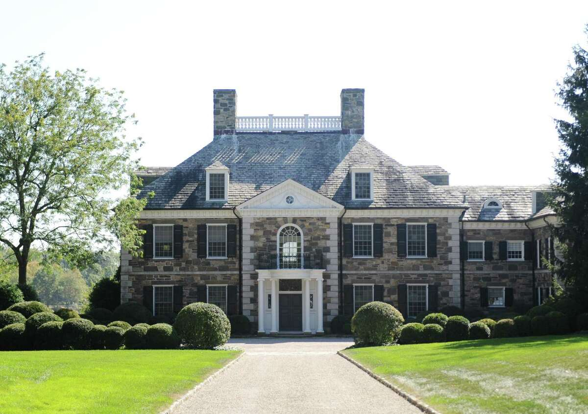 The Georgian colonial mansion on Oneida Drive in Greenwich, Conn., photographed here on Wednesday, Oct. 4, 2017, recently sold for more than $20 million. The 9,780 sq. ft. home sits on nearly four acres in a gated community on Indian Harbor.