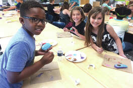 "Woodland Elementary students paint rocks with positive messages and bright colors in conjunction with reading ""Only One You."" The rocks have been added to the school's butterfly garden."
