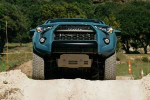Toyota's 4Runner TRD Pro shows off its skid plate as the SUV runs an off-road course developed for this year's Texas Truck Rodeo.